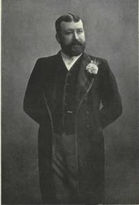George Sims. Photograph by Ellis and Waller. Public Domain.